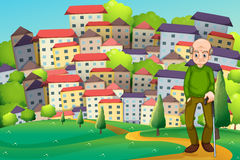 A grandfather at the hilltop across the village Stock Image
