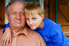 Grandfather and his beloved ones boys Stock Images