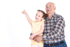 Grandfather with his grand daughter Stock Photos