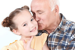 Grandfather with his grand daughter Stock Images