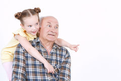 Grandfather with his grand daughter Stock Photo