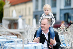 Grandfather and his grandchild in outdoor cafe Royalty Free Stock Photo