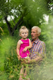 Grandfather with his granddaughter Stock Images