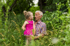 Grandfather with his granddaughter Royalty Free Stock Images