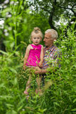 Grandfather with his granddaughter Royalty Free Stock Photo