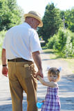 Grandfather with his granddaughter are on the road Royalty Free Stock Image
