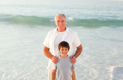 Grandfather and his grandson at the beach Royalty Free Stock Photos