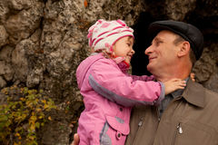 Grandfather hold granddaughter in his hands royalty free stock photos