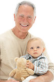 Grandfather Holding Grandson With Teddy Bear Stock Photos