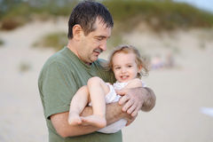 Grandfather holding his granddaughter Royalty Free Stock Photo