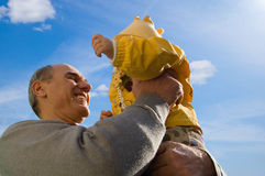 Grandfather holds his granddaughter in hands Royalty Free Stock Images