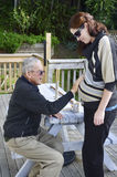 Grandfather holds his pregnant granddaughter abdomen Stock Images