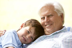 Grandfather Hugging Grandson In Park Royalty Free Stock Images