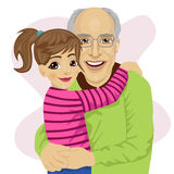 Grandfather hugging her cute granddaughter Royalty Free Stock Photos