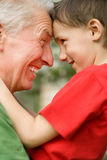 Grandfather keeps his grandson. In an outdoor Stock Images