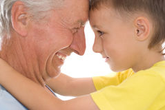 Grandfather keeps his grandson Stock Photos