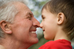 Grandfather keeps his grandson Royalty Free Stock Photos