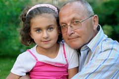 Grandfather and kid outdoors Royalty Free Stock Images