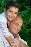 Grandfather and kid outdoors Royalty Free Stock Image