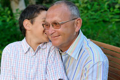 Grandfather and kid outdoors Stock Photos