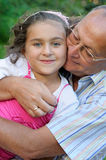Grandfather and kid outdoors Stock Images