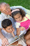 Grandfather and kids outdoors Stock Image