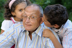 Grandfather and kids outdoors Royalty Free Stock Photo