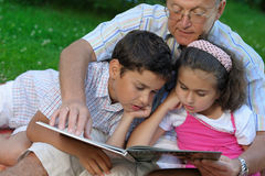 Grandfather and kids outdoors stock photos