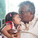 Grandfather kissing granddaughter Stock Photo