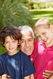 Grandfather laughing with grandchildren Royalty Free Stock Image