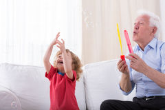 Grandfather letting bubbles Stock Photography