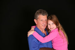 Grandfather and little girl Stock Image