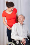 Grandfather looking on granddaughter Royalty Free Stock Photography