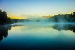 Grandfather Mountain Sunrise Reflections on Julian Price Lake in Stock Photos