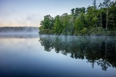Grandfather Mountain Sunrise Reflections on Julian Price Lake in Royalty Free Stock Photography