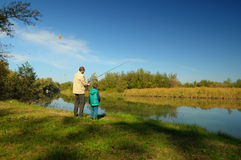 Grandfather and nephew fishing Royalty Free Stock Image