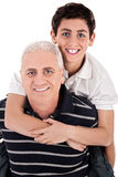 Grandfather piggybacking his grandson Royalty Free Stock Photos