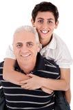 Grandfather piggybacking his grandson Royalty Free Stock Photos