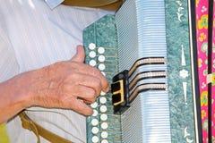 Grandfather play on accordion. Closeup stock illustration