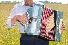 Grandfather play on accordion. Focus on accordion royalty free illustration