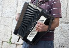 Grandfather playing on accordion. Stock Photo