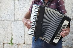 Grandfather playing on accordion. Stock Images