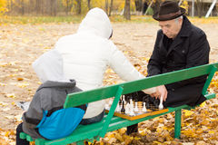 Grandfather playing chess with his daughter Royalty Free Stock Image