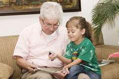 Grandfather playing with his granddaughter Royalty Free Stock Image