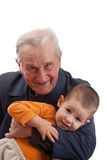 Grandfather playing whit grandson Stock Photos