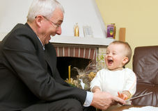 Grandfather Playing With Child Stock Images