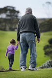 Grandfather plays with grand daughter Stock Photography