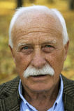 Grandfather portrait in park Royalty Free Stock Image