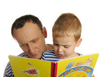 Grandfather read book with grandson Stock Image
