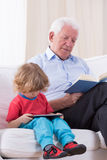 Grandfather reading book Stock Image